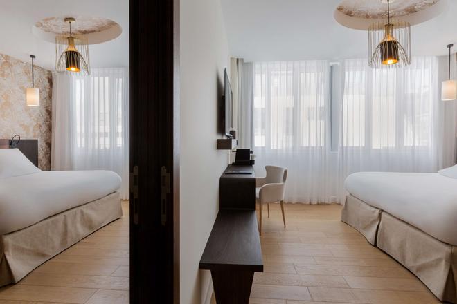 貝斯特韋斯特高級精選喬木旅行者酒店 - 里耳 - 里爾 - 臥室