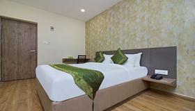Treebo Trend Ocean Suites - Mumbai - Bedroom