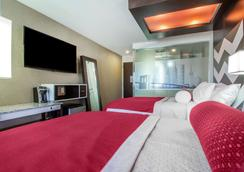 The Vue Hotel Ascend Hotel Collection - Queens - Schlafzimmer