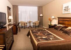 Howard Johnson Hotel & Convention Center by Wyndham, Merlo - Villa de Merlo - Bedroom