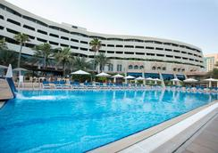 Occidental Sharjah Grand - Sharja - Piscina