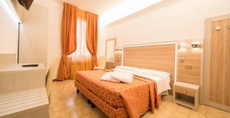 阿爾貝格卡蘭西尼旅館 - 薩索馬吉奧萊 德曼 - 臥室