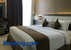 Crystal Lotus Hotel Yogyakarta by Prabu - Yogyakarta - Bedroom