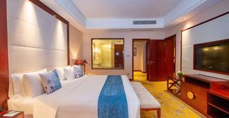 Howard Johnson Tropical Garden Plaza Kunming - Kunming - Soveværelse