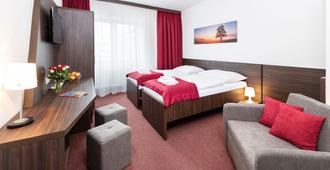 Hotel Plus - ברטיסלבה - חדר שינה