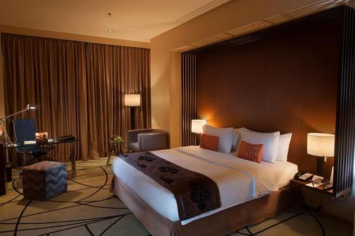 Cambridge Hotel Medan - Medan - Bedroom