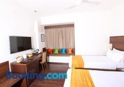 Temple Tree Hotel - Bengaluru - Bedroom