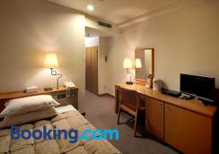 Kagoshima Sun Royal Hotel - Kagoshima - Bedroom