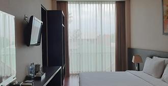 أوسيس سيليوانجي سبورت هوتل - باندونغ - غرفة نوم