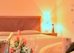 โรงแรมจีโอวิลเลจ - ออลเบีย - ห้องนอน