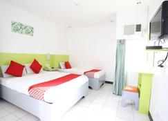 OYO 210 Apple Tree Suites - Cebu City - Bedroom