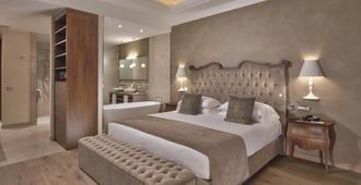 Grand Hotel Fasano - גארדונה ריביירה - חדר שינה