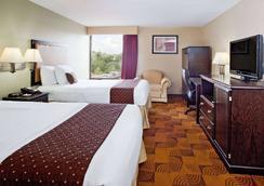 La Quinta Inn & Suites by Wyndham Memphis Airport Graceland - Memphis - Schlafzimmer