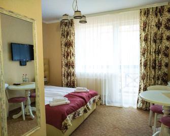 Hotel & Restaurant Premium Club - Yaremche - Slaapkamer