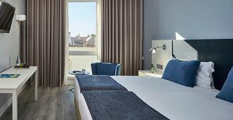 Hotel Faro & Beach Club - פארו