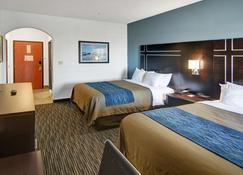 Comfort Inn & Suites Beachfront - Galveston - Bedroom