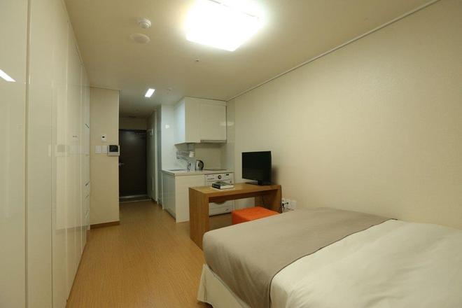 納維飯店 - 首爾 - 臥室