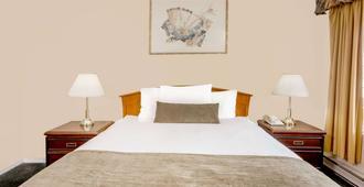坎盧普斯市中心豪生大酒店 - 坎盧普斯 - 坎盧普斯 - 臥室