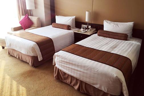 Howard Johnson by Wyndham Huaihai Hotel Shanghai - Shanghai - Bedroom