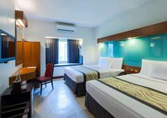 Microtel by Wyndham UP Technohub - Quezon City - Bedroom