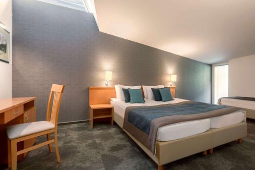 Ramada Resort by Wyndham Kranjska Gora - Kranjska Gora - Makuuhuone