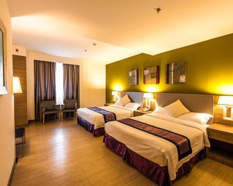 Badi'ah Hotel - Μπαντάρ Σερί Μπεγκαβάν - Κρεβατοκάμαρα