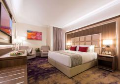 Ramada by Wyndham Continental Jeddah - Jeddah - Bedroom