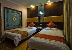 Super 8 by Wyndham Yangzhou Slender West Lake Wen Chang Ge - Yangzhou - Bedroom