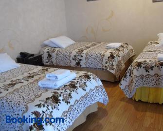 Latacunga Hostel - Латакунга - Bedroom