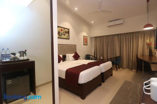 7 Apple Resorts - Lonavala - Phòng ngủ