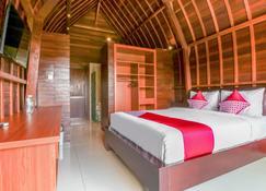 OYO 1254 Sekar Arum Guest House - Kediri - Habitación