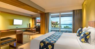 Hotel Nikko Bali Benoa Beach - South Kuta - Bedroom