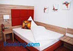Hotel Isartaler Hof - Wolfratshausen - Bedroom
