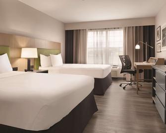 Country Inn & Suites by Radisson, Waterloo, IA - Уотерлоо - Спальня