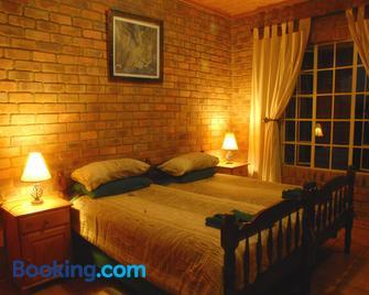 Thaba Tsweni Lodge & Safaris - Graskop - Bedroom