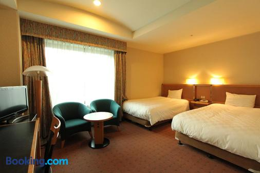 名古屋花園宮殿酒店 - 名古屋 - 臥室