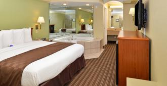 Americas Best Value Inn & Suites University Ave - ליטל רוק - חדר שינה