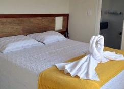 Hotel Escarpas do Lago - קאפיטוליו - חדר שינה