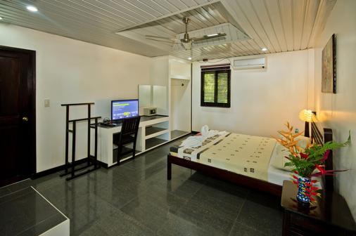 Balay Tuko Garden Inn - Puerto Princesa - Bedroom