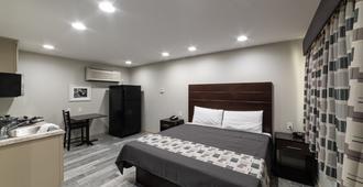 Budget Inn & Suites - Baton Rouge - Bedroom