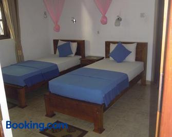 Devi Tourist Home - Полоннарува - Спальня
