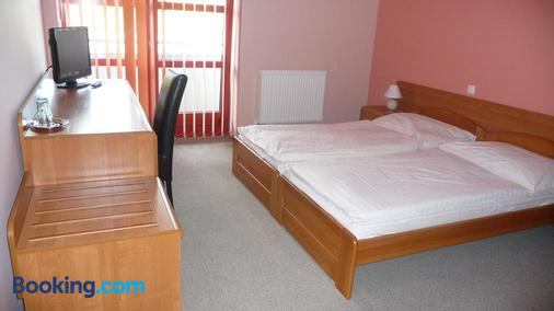 Penziónq - Zvolen - Bedroom