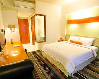 Harris Hotel Batam Center - Batam - Bedroom