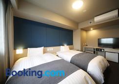 Hotel Dormy Inn Miyazaki Natural Hot Spring - Miyazaki - Phòng ngủ