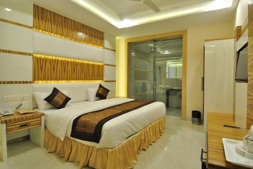 Hotel Aman Continental - New Delhi - Phòng ngủ