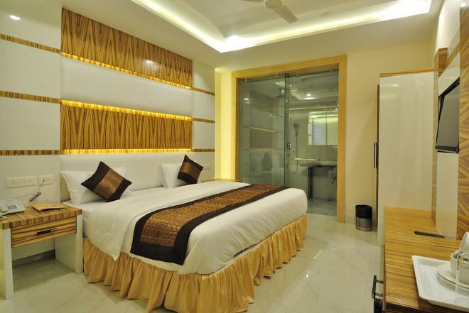 Hotel Aman Continental - New Delhi - Slaapkamer