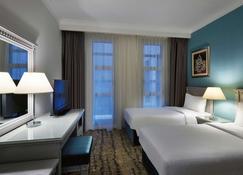 Anwar Al Madinah Mövenpick Hotel - Medina - Schlafzimmer