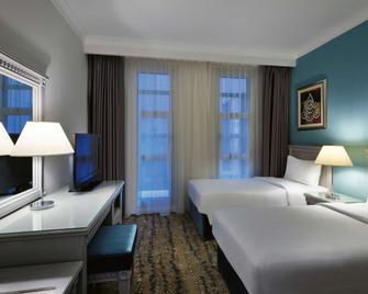 Anwar Al Madinah Mövenpick Hotel - Medina - Bedroom