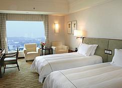 Kande International Hotel Huizhou - Huizhou - Bedroom