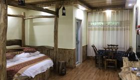 Yuping Inn - Zhangjiajie - Bedroom